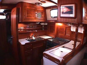 The nice woodwork, window, and picture are appealing in this galley.